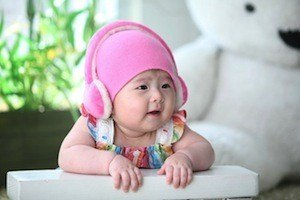 Eeh bah gum! You've got ear worms! Photo of baby wearing headphones