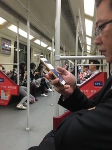 How to talk to strangers - photo of people focusing on their 'phones